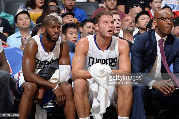 Chris Paul of the Los Angeles Clippers and Blake Griffin of the Los Angeles Clippers sit on the bench against the Golden State Warriors at STAPLES...