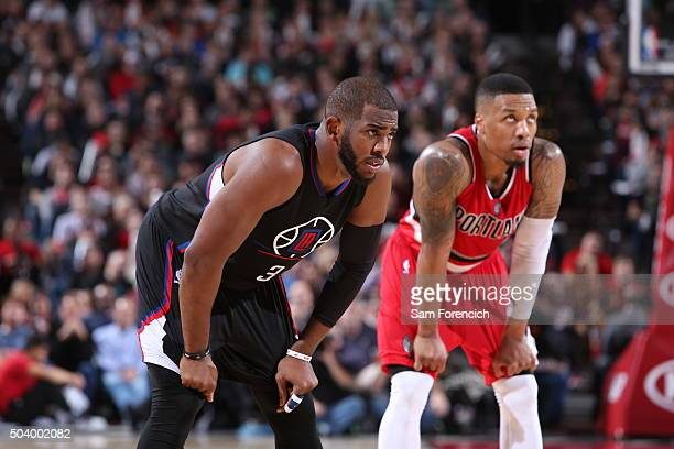 Chris Paul of the Los Angeles Clippers and Damian Lillard of the Portland Trail Blazers strand on the court on January 6 2015 at the Moda Center...