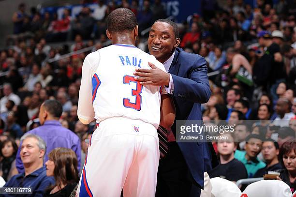 Chris Paul of the Los Angeles Clippers and Isiah Thomas hug during a game between the Los Angeles Clippers and the Detroit Pistons at STAPLES Center...