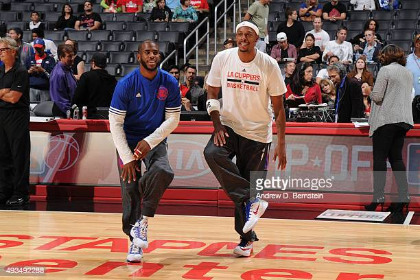 Chris Paul of the Los Angeles Clippers and Josh Smith of the Los Angeles Clippers warms up before the game against the Golden State Warriors on...