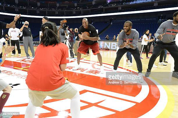 Chris Paul of the Los Angeles Clippers and legend Jerome Williams interacts with the kids during a NBA Cares clinic as part of the 2015 NBA Global...
