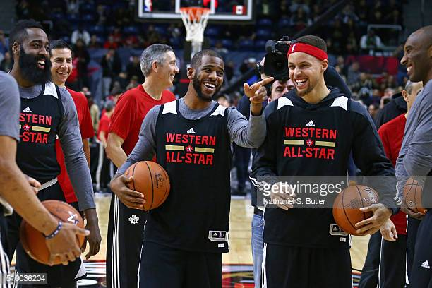 Chris Paul of the Los Angeles Clippers and Stephen Curry of the Golden State Warriors smile and laugh during the NBA AllStar Practice as part of 2016...