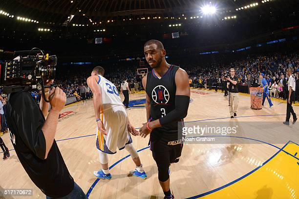 Chris Paul of the Los Angeles Clippers and Stephen Curry of the Golden State Warriors shake hands on March 23 2016 at Oracle Arena in Oakland...