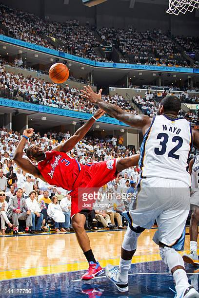 Chris Paul of the Los Angeles Clippers attempts an offbalance shot against OJ Mayo of the Memphis Grizzlies in Game Five of the Western Conference...