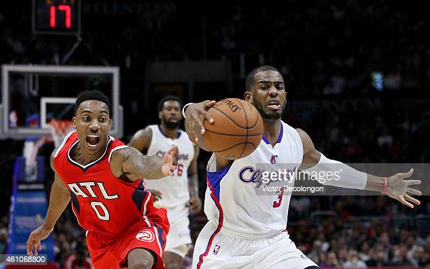 Chris Paul of the Los Angeles Clippers controls the ball before Jeff Teague of the Atlanta Hawks can get a hand on the ball in the first half during...