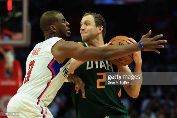 Chris Paul of the Los Angeles Clippers defends against Joe Ingles of the Utah Jazz during the second half of Game Five of the Western Conference...