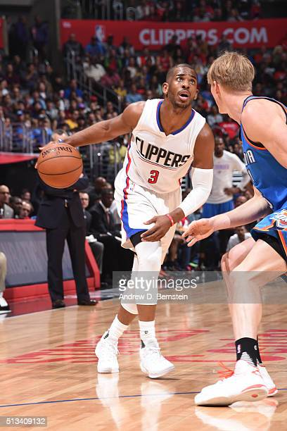 Chris Paul of the Los Angeles Clippers defends the ball against the Oklahoma City Thunder during the game on March 2 2016 at STAPLES Center in Los...