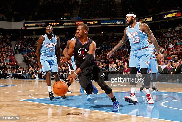 Chris Paul of the Los Angeles Clippers dribbles away from Quincy Acy and DeMarcus Cousins of the Sacramento Kings at Sleep Train Arena on February 26...