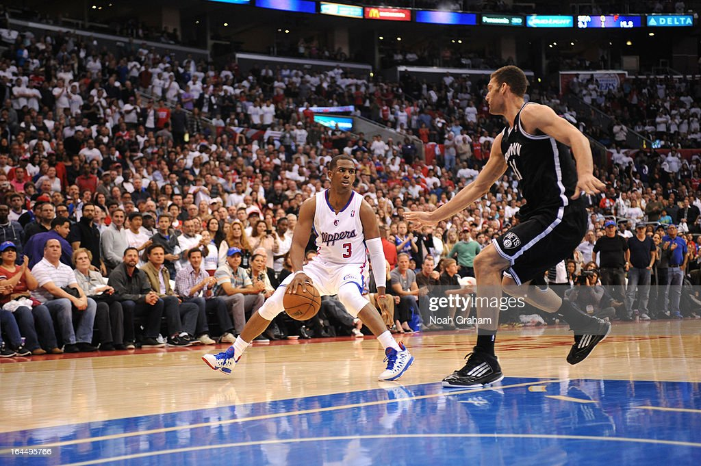 Chris Paul #3 of the Los Angeles Clippers drives against Brook Lopez #11 of the Brooklyn Nets during the game between the Los Angeles Clippers and the Brooklyn Nets at Staples Center on March 23, 2013 in Los Angeles, California.