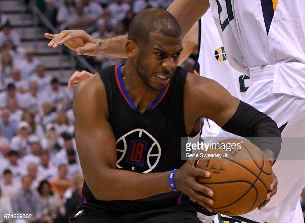 Chris Paul of the Los Angeles Clippers drives past Rudy Gobert of the Utah Jazz in the second half of their 9893 win in Game Six of the Western...
