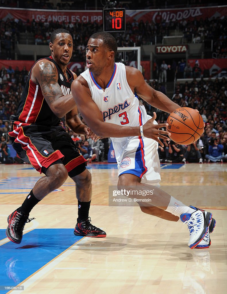 Chris Paul #3 of the Los Angeles Clippers drives to the basket against Mario Chalmers #15 of the Miami Heat at Staples Center on November 14, 2012 in Los Angeles, California.
