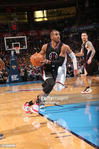 Chris Paul of the Los Angeles Clippers drives to the basket against the Oklahoma City Thunder on March 9 2016 at Chesapeake Energy Arena in Oklahoma...