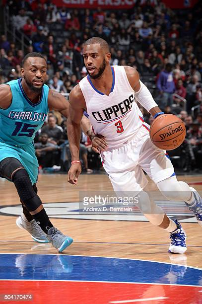 Chris Paul of the Los Angeles Clippers drives to the basket during the game against the Charlotte Hornets on January 9 2016 at STAPLES Center in Los...