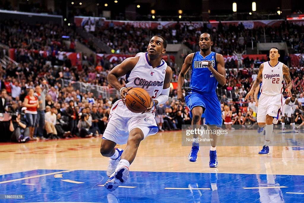 Chris Paul #3 of the Los Angeles Clippers drives to the basket on a fast break against the Dallas Mavericks at Staples Center on January 9, 2013 in Los Angeles, California.