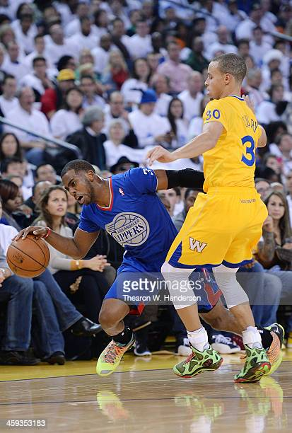 Chris Paul of the Los Angeles Clippers gets fouled by Stephen Curry of the Golden State Warriors during the first quarter at ORACLE Arena on December...