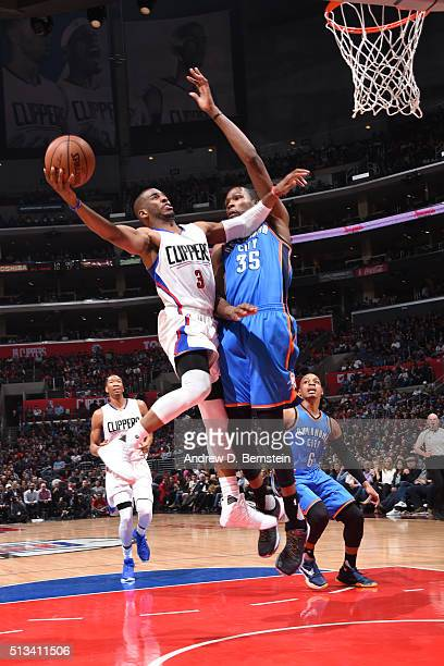 Chris Paul of the Los Angeles Clippers goes for the dunk against Kevin Durant of the Oklahoma City Thunder during the game on March 2 2016 at STAPLES...
