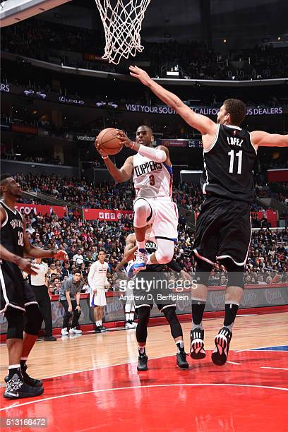 Chris Paul of the Los Angeles Clippers goes for the layup against Brook Lopez of the Brooklyn Nets during the game on February 29 2016 at Staples...