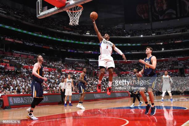 Chris Paul of the Los Angeles Clippers goes to the basket against the Utah Jazz in Game One of Round One during the 2017 NBA Playoffs on April 15...