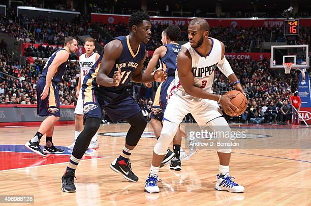 Chris Paul of the Los Angeles Clippers handles the ball against Jrue Holiday of the New Orleans Pelicans on November 27 2015 at STAPLES Center in Los...