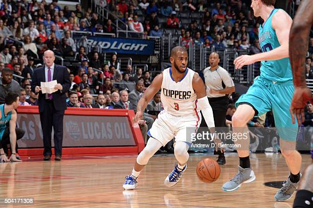 Chris Paul of the Los Angeles Clippers handles the ball during the game against the Charlotte Hornets on January 9 2016 at STAPLES Center in Los...