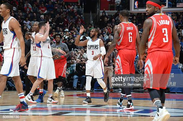 Chris Paul of the Los Angeles Clippers high fives teammates during the game against the Houston Rockets on January 18 2016 at STAPLES Center in Los...
