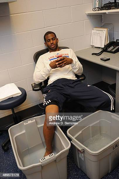 Chris Paul of the Los Angeles Clippers ices his foot before a game against the Oklahoma City Thunder in Game Four of the Western Conference...