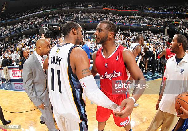 Chris Paul of the Los Angeles Clippers is congratulated by Mike Conley of the Memphis Grizzlies after winning Game Seven of the Western Conference...