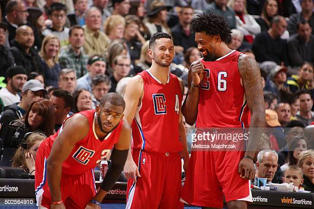 Chris Paul of the Los Angeles Clippers JJ Redick of the Los Angeles Clippers and DeAndre Jordan of the Los Angeles Clippers talk during the game...