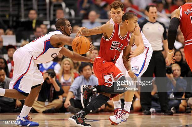 Chris Paul of the Los Angeles Clippers knocks the ball loose from the hand of Derrick Rose of the Chicago Bulls at Staples Center on December 30 2011...