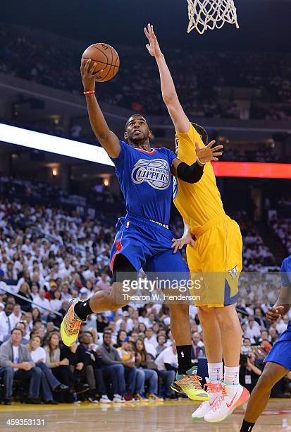 Chris Paul of the Los Angeles Clippers lays the ball up over Klay Thompson of the Golden State Warriors during the first quarter at ORACLE Arena on...