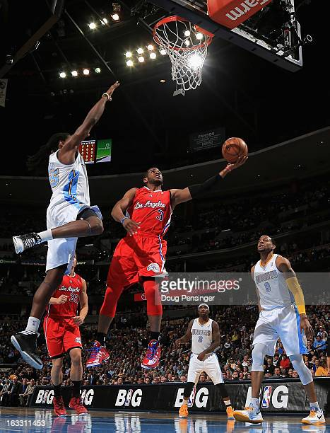Chris Paul of the Los Angeles Clippers lays up a shot only to have it blocked by Kenneth Faried of the Denver Nuggets at the Pepsi Center on March 7...