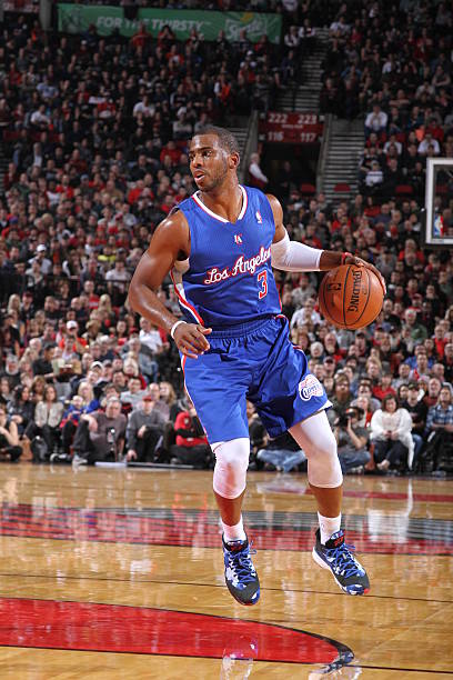Chris Paul of the Los Angeles Clippers looks to pass...