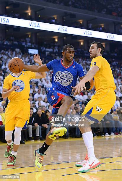 Chris Paul of the Los Angeles Clippers looks to pass the ball around Andrew Bogut of the Golden State Warriors during the first quarter at ORACLE...