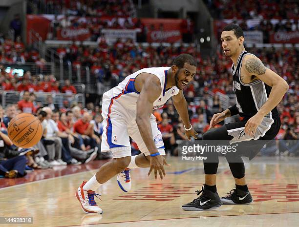 Chris Paul of the Los Angeles Clippers looses the ball against Manu Ginobili of the San Antonio Spurs in the fourth quarter in Game Four of the...