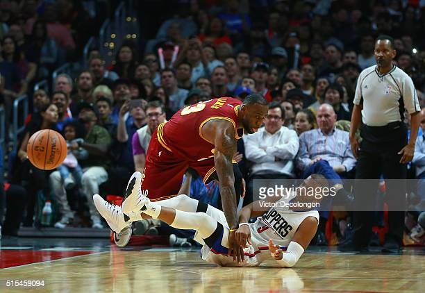 Chris Paul of the Los Angeles Clippers passes the ball away from LeBron James of the Cleveland Cavaliers during the first half of their NBA game at...