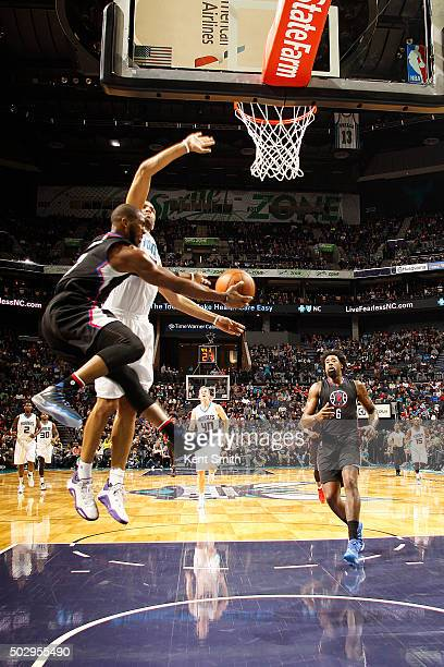 Chris Paul of the Los Angeles Clippers passes the ball to DeAndre Jordan of the Los Angeles Clippers during the game against the Charlotte Hornets on...