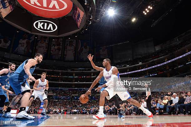 Chris Paul of the Los Angeles Clippers passes to teammate Blake Griffin during their game against the Minnesota Timberwolves at Staples Center on...