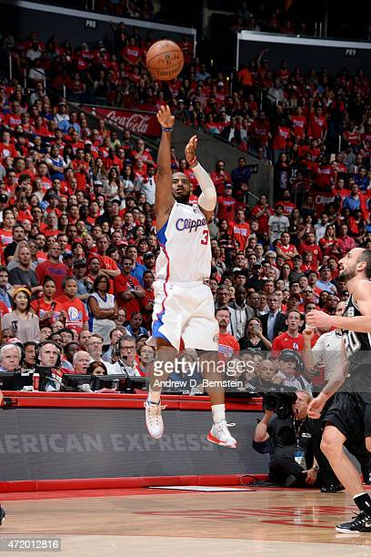 Chris Paul of the Los Angeles Clippers shoots a buzzer beater three pointer against the San Antonio Spurs in Game Seven of the Western Conference...
