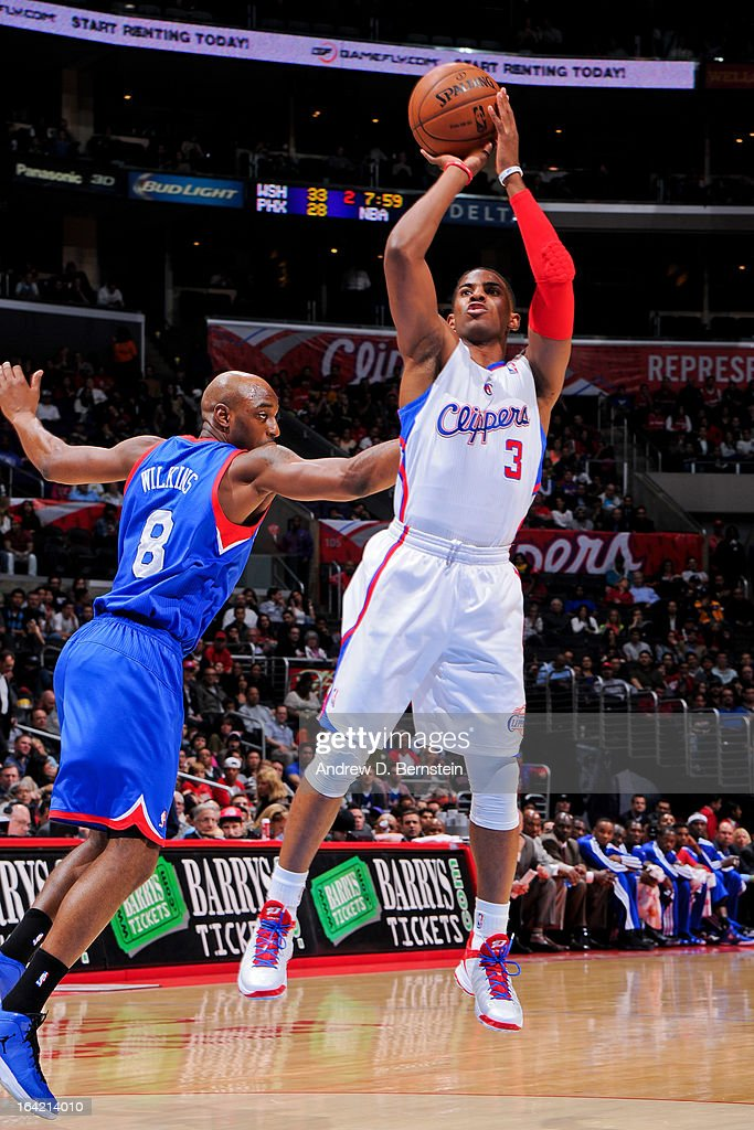 Chris Paul #3 of the Los Angeles Clippers shoots against Damien Wilkins #8 of the Philadelphia 76ers at Staples Center on March 20, 2013 in Los Angeles, California.