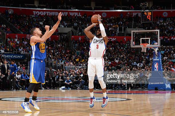 Chris Paul of the Los Angeles Clippers shoots against Stephen Curry of the Golden State Warriors on November 19 2015 at STAPLES Center in Los Angeles...