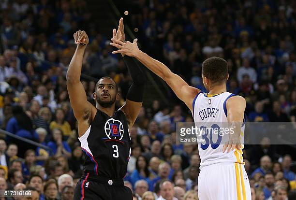 Chris Paul of the Los Angeles Clippers shoots over Stephen Curry of the Golden State Warriors at ORACLE Arena on March 23 2016 in Oakland California...