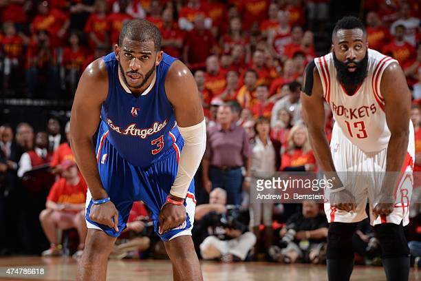 Chris Paul of the Los Angeles Clippers stands on the court in Game Seven of the Western Conference Semifinals with James Harden of the Houston...