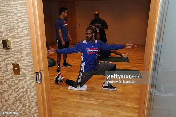 Chris Paul of the Los Angeles Clippers stretches before the game against the Utah Jazz on March 14 2014 in Salt Lake City Utah NOTE TO USER User...