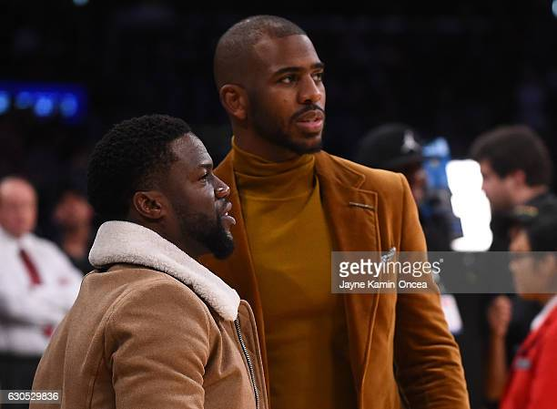 Chris Paul of the Los Angeles Clippers talks with actor Kevin Hart during the game against the Los Angeles Lakers at Staples Center on December 25...