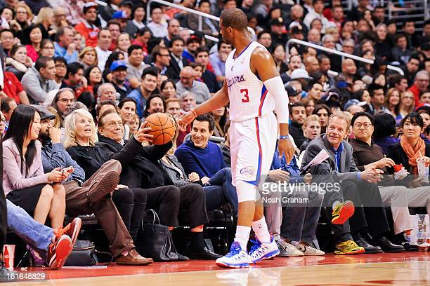 Chris Paul of the Los Angeles Clippers tosses a basketball to team owner Donald Sterling during a game against the Houston Rockets at Staples Center...