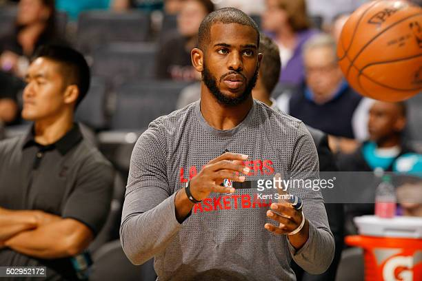 Chris Paul of the Los Angeles Clippers warms up before the game against the Charlotte Hornets at the Time Warner Cable Arena on December 30 2015 in...