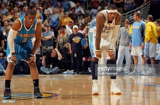Chris Paul of the New Orleans Hornets and Carmelo Anthony of the Denver Nuggets await action in Game Two of the Western Conference Quarterfinals...