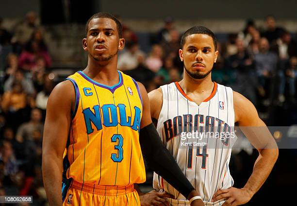 Chris Paul of the New Orleans Hornets and DJ Augustin of the Charlotte Bobcats take in the action during the game on January 15 2011 at Time Warner...