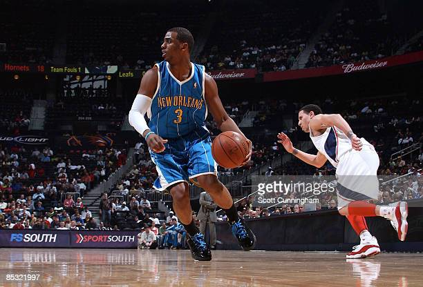 Chris Paul of the New Orleans Hornets brings the ball up against Mike Bibby of the Atlanta Hawks at Philips Arena on March 9 2009 in Atlanta Georgia...