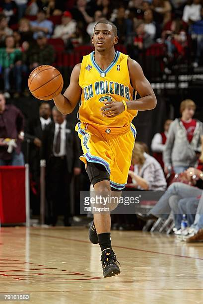Chris Paul of the New Orleans Hornets brings the ball upcourt during the game against the Houston Rockets on January 13 2008 at the Toyota Center in...